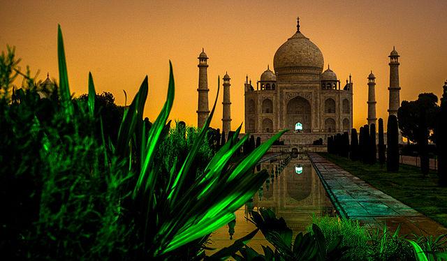 Taj Mahal in Midnight with City Lights illuminating the background.jpg