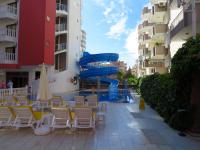 территория отеля (корпус С и бассейн с горкой)