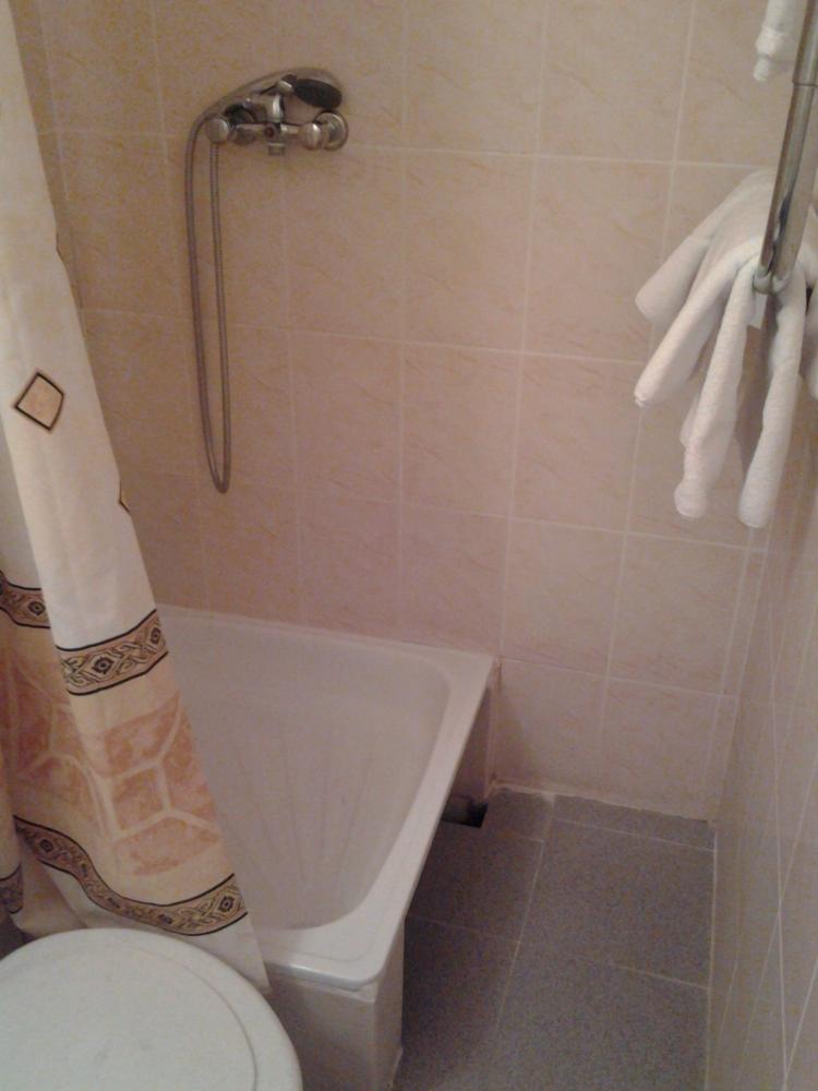 Сидячая ванна и полотенца