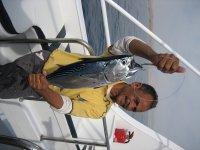 Матрос поймал рыбку к обеду
