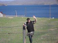 Это моя жена на фоне вида на Байкал с базы.
